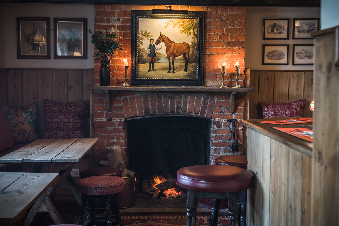 Cosy bar with real log fire